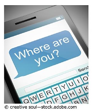 "Image of a mobile phone with a text message ""where are you?"" on screen"