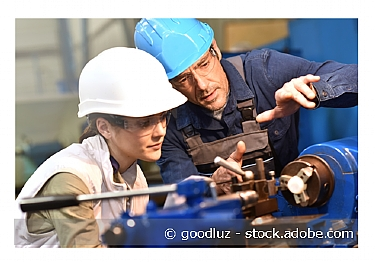 Image of young worker being supervised