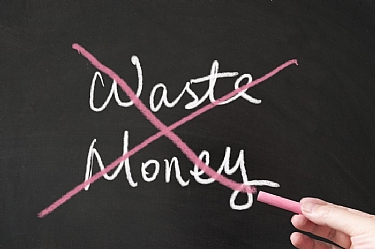 Image of chalk board with don't waste money written on it
